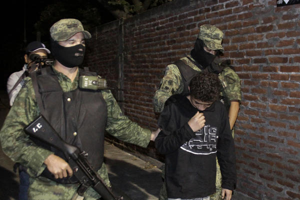 "Mexican soldiers present Edgar Jimenez Lugo, known as ""El Ponchis,"" to the media in the city of Cuernavaca in 2010."