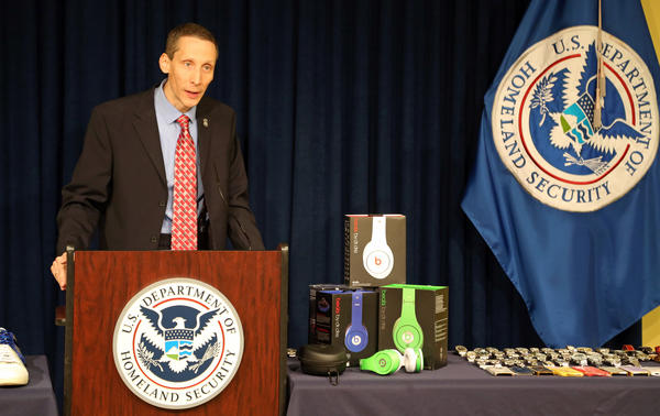 Gerard O'Neill, assistant special agent in charge of Homeland Security Investigations in South Florida, warns consumers to be wary of holiday shopping scams designed to dupe them into buying counterfeit products. Susan Stocker, Sun Sentinel