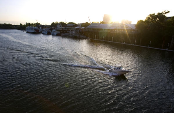 A small craft makes its way south on the Sacramento River. A man died when his excavator fell into the river Monday.