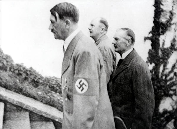British Prime Minister Neville Chamberlain, right, with Adolf Hitler.