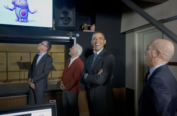 President Obama reacts to hearing his remarks used as the voice for an animated character during a tour of the recording studio at DreamWorks Animation studios in Glendale on Tuesday.