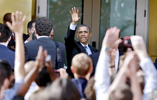 President Barack Obama waves goodbye to the crowd after speaking for about half hour at DreamWorks in Glendale on Tuesday, Nov. 26, 2013.
