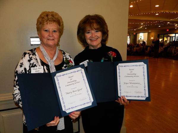Mary Ann Gent, left, and Joyce Wisniowicz hold their awards for Outstanding Community Service after a recent ceremony at Orland Chateaux.