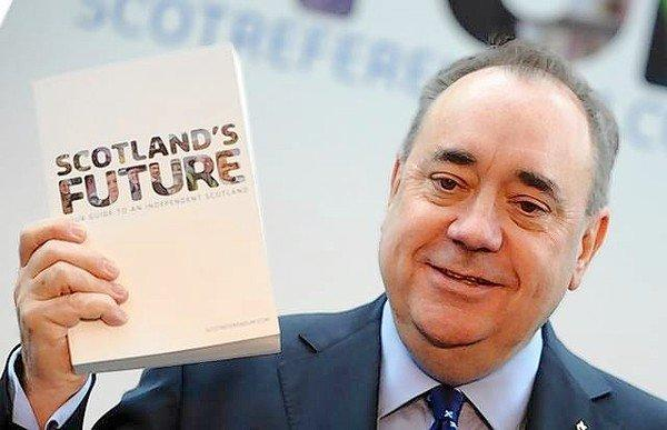 Scottish First Minister Alex Salmond holds up the government's newly released blueprint for secession from Britain.