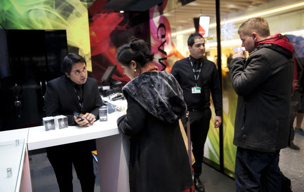 Customers at the Gamucci Electronic Cigarette Zone that opened Monday at Heathrow Airport in London.