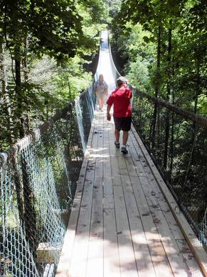 Guests to Foxfire Mountain in eastern Tennessee brave America's longest swinging bridge as they cross Dunn's Gorge high above the Pigeon River.