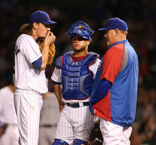 Cubs starting pitcher Jeff Samardzija gets a visit to the mound pitching coach Chris Bosio while catcher Welington Castillo listens in.