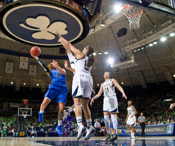 DePaul's Brittany Hrynko goes up for a shot as Notre Dame's Jewel Loyd and Taya Reimer defend in the first half at the Purcell Pavilion.