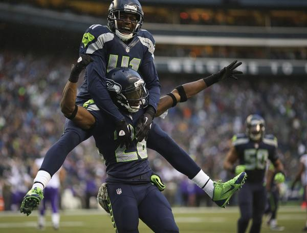 Walter Thurmond celebrates his fourth-quarter interception for a touchdown against the Vikings with teammate Byron Maxwell.