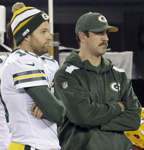 Packers quarterbacks Matt Flynn and Aaron Rodgers.
