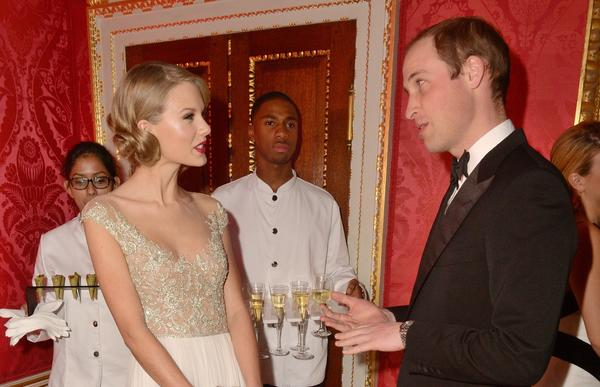 Singer Taylor Swift meets Britain's Prince William, Duke of Cambridge during the Winter White Gala dinner in aid of youth homeless charity Centrepoint at Kensington Palace in London on Nov. 26, 2013.