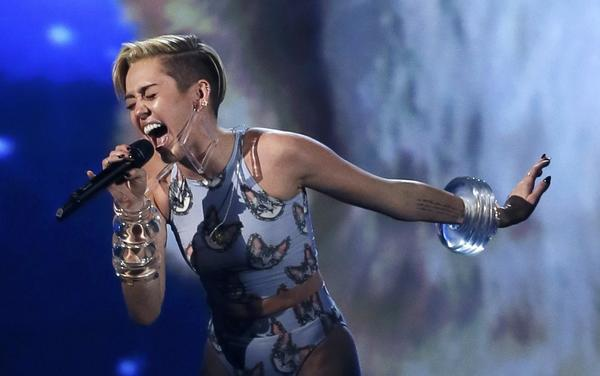 "Miley Cyrus performs ""Wrecking Ball"" at the 41st American Music Awards in Los Angeles on Nov. 24."