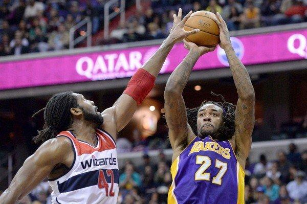 Jordan Hill shoots over Washington power forward Nene Hilario during the Lakers' 116-111 loss to the Wizards at the Verizon Center in Washington, D.C. on Tuesday.