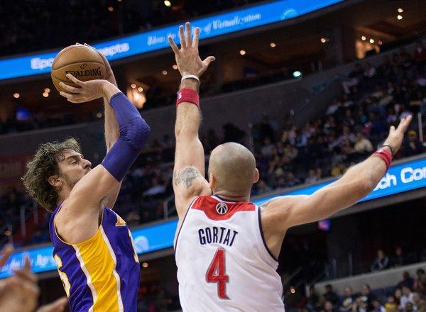 Paul Gasol shoots over Marcin Gortat during the Lakers' loss to the Washington Wizards, 116-111, on Tuesday at the Verizon Center in Washington, D.C.