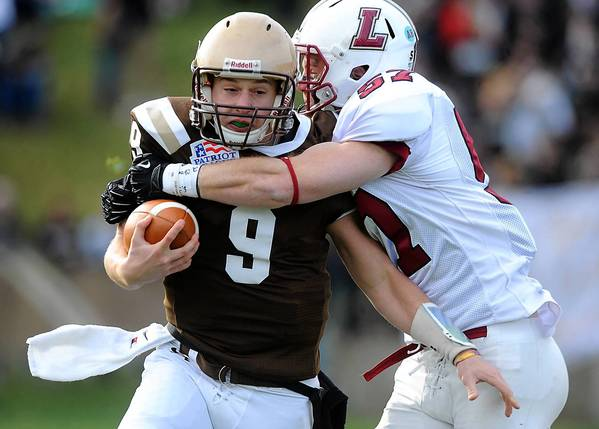 Lafayette's Ben Aloi (right) sacks Lehigh's Nick Shafnisky (left) during their 149th meeting in college football Saturday afternoon.