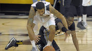 Down a starter, Towson basketball finds its footing in 2nd half of 75-60 win vs. UMBC