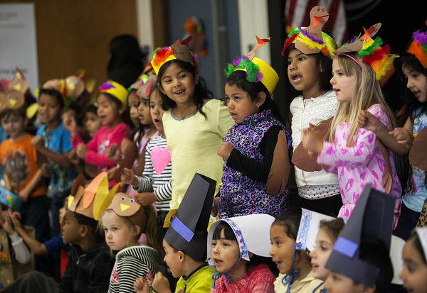 Kindergartners at Adams Elementary School sing a song during the school's annual kindergarten Thanksgiving feast on Tuesday, Nov. 26.