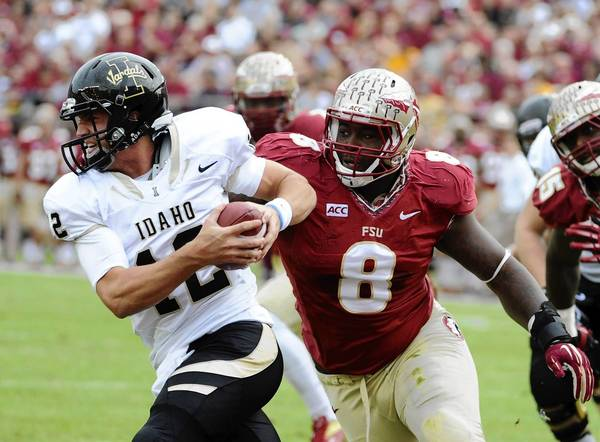 Seminoles defensive tackle Timmy Jernigan pressures Idaho Vandals quarterback Taylor Davis.