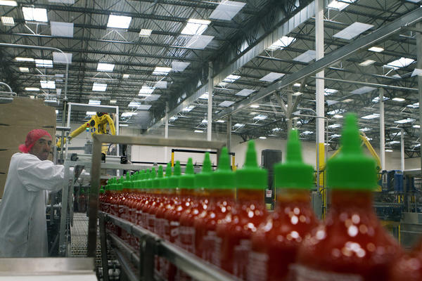 Manuel Benitez works in the packaging area at Huy Fong Foods Inc. in Irwindale A judge Tuesday ordered the plant to cease any operations that may be contributing to health problems of nearby residents.