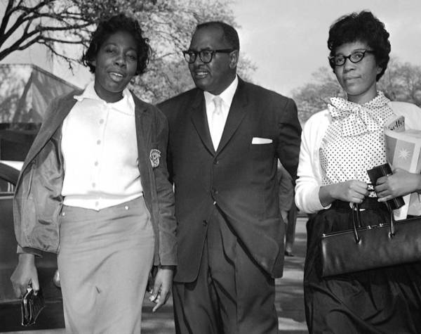 The Rev. T.J. Jemison escorts civil rights protesters Mary Briscoe, left, and Sandra Ann Jones after they were released from jail in Baton Rouge, La., in April 1960.