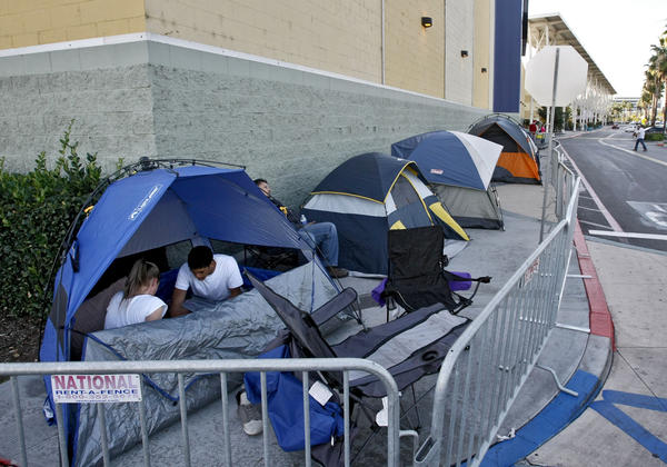 About 10 people with tents make an early line at the side of Best Buy as they wait for Black Friday, in Burbank on Tuesday, Nov. 26, 2013.