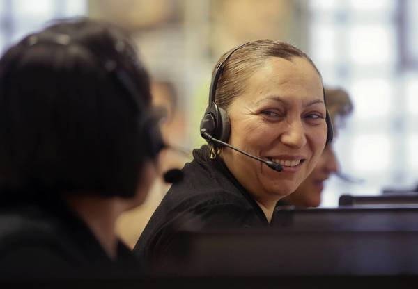 Oprima-1 participants Margarita Lopez, left, and Zenaida Soto make outgoing calls at the Poder Learning Center as part of the program's job skills component.
