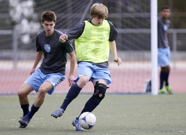 Crescenta Valley High boys' soccer players Justin Wright, left, and Matt Ryan, right, work on dribbling during practice at the school's field. (Raul Roa/Staff Photographer)