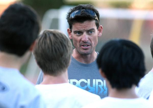 La Caada High boys' soccer coach Alex Harrison address his team at practice on Tuesday. His Spartans will have a more defensive look and identity in 2013-14. (Tim Berger/Staff Photographer)