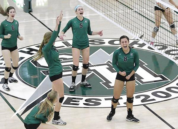 Sage Hill School's Kekai Whitford (8) celebrates after a kill, as Sophie Gordon (6) Maddy Abbott (15) and Juliette Singarella (5) join her in the first round of the CIF State Southern California Division III playoffs.