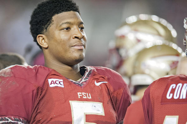 Jameis Winston #5 of the Florida State Seminoles rests on the sideline during the second half against the Idaho Vandals at Doak Campbell Stadium.