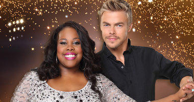"Amber Riley takes the stage with Derek Hough. She plays Mercedes Jones on Fox's musical comedy ""Glee."""