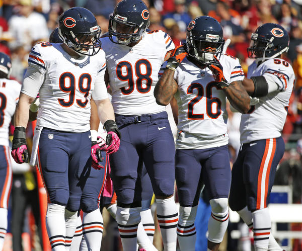 Chicago Bears defensive end Shea McClellin (99) chats with Chicago Bears defensive end Corey Wootton (98) during the Redskins game.