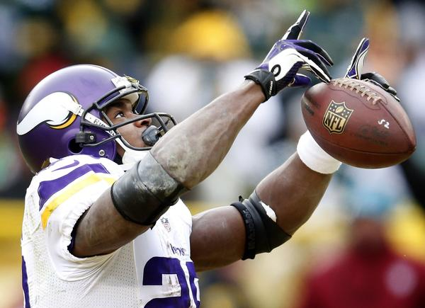 Vikings running back Adrian Peterson celebrates after scoring a touchdown against the Packers Sunday.