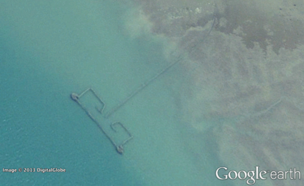 A Google Earth image includes a fishing weir along the Persian Gulf coast. A study estimated that catches from large fish traps in the region were nearly six times higher than official statistics reported.