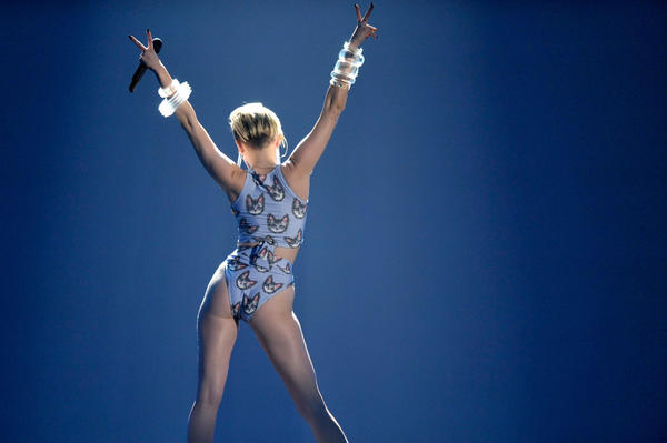 Miley Cyrus added to the media frenzy with her performance at the American Music Awards on Nov. 24, 2013, in Los Angeles.
