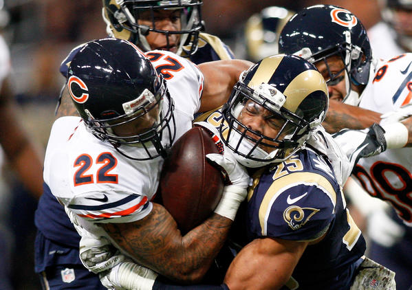 Chicago Bears running back Matt Forte is tackled by St. Louis Rams strong safety T.J. McDonald Sunday.