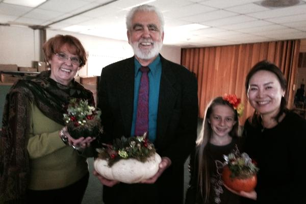 "La Canada United Methodist Church celebrated Thanksgiving with an ""All Church Luncheon."" Cherie Nordlof, Bob Rinker, Christine Ecker and Pastor Elaine Cho show off one-of-a-kind pumpkin planter centerpieces that decorated the room."