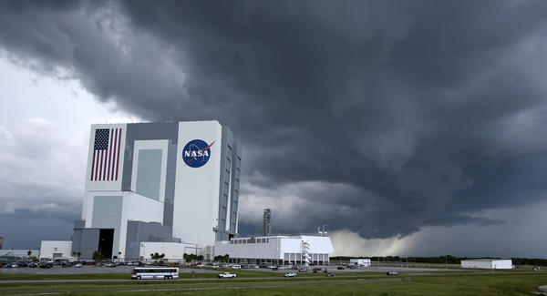 A huge storm cloud loaded with rain and lightning approaches the Vehicle Assembly Building on June 17, 2013 at the Kennedy Space Center.