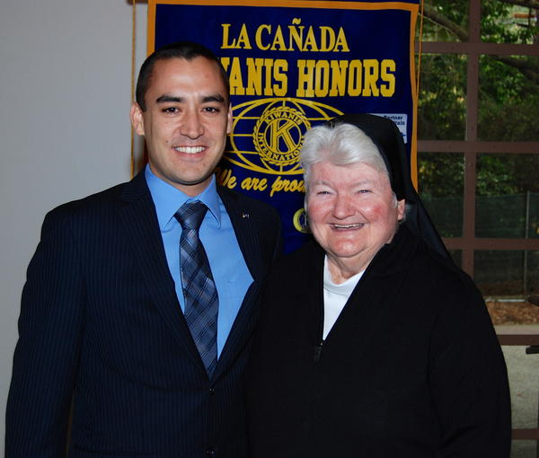 Kyle Hara, Kiwanis Vice President and Prorag Chairman, is shown with Sister Carolyn McCormack, President of Flintridge Sacred Heart Academy.