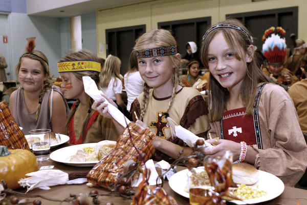 Dresses as indians, from left to right are, Devyn Cox, Haley Decker, Sophie Clarkson and Emily Strauss before enjoying a Thanksgiving feast at La Canada Elementary School in La Canada Flintridge on Friday, Nov. 22, 2013.