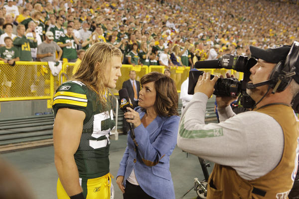 NBC Sports reporter Michele Tafoya interviews Green Bay Packer Clay Matthews.