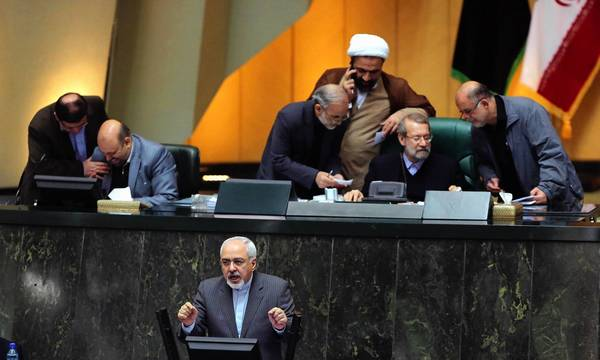 Iranian Foreign Minister Mohammad Javad Zarif, foreground, speaks to the parliament in Tehran about the nuclear deal he helped negotiate in Geneva.