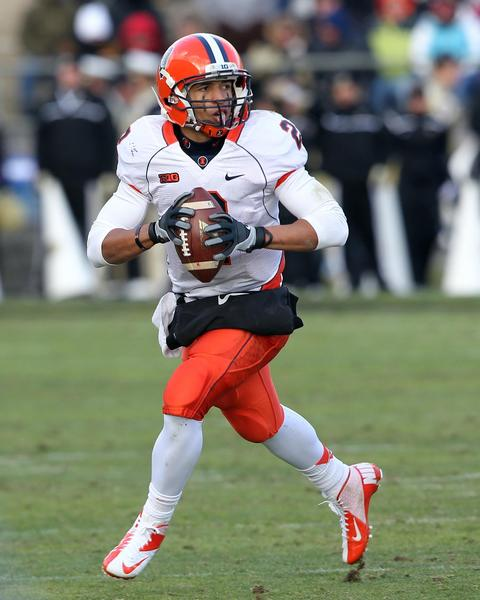 Illinois quarterback Nathan Scheelhaase scrambles with the ball during the fourth quarter against Purdue.