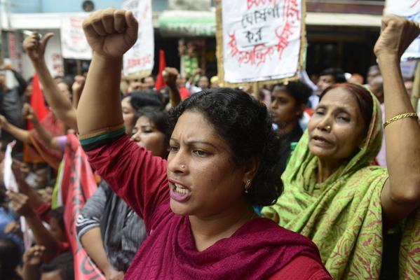 Bangladeshi garment workers shout slogans during a protest demanding wage increases in Dhaka.
