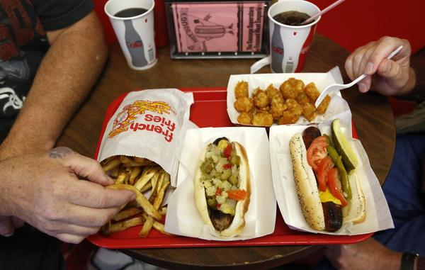 Customers eat at Hot Doug's restaurant in Chicago.