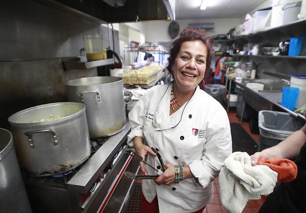 Chef Lorrie Sanchez steps into her role as the official turkey cook for the Thanksgiving dinner at the Someone Cares Soup Kitchen in Costa Mesa on Wednesday. Sanchez will cook four turkeys at one time that will feed hundreds of people who count on a Thanksgiving dinner.