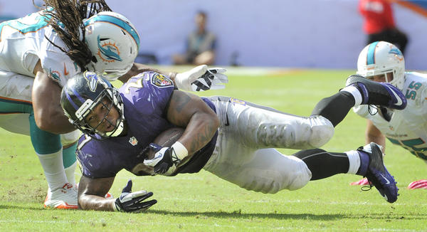 Ravens running back Ray Rice is brought down in the fourth quarter against the Miami Dolphins in October.