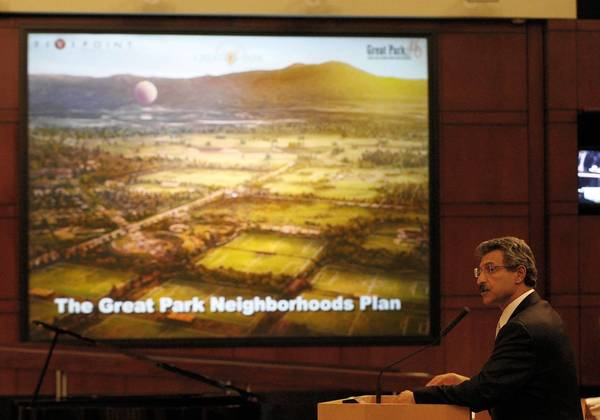 Emile Haddad, president and chief executive of FivePoint Communities, addresses the Irvine City Council about housing on the Great Park site during its Tuesday night meeting.The council approved a scaled-down version of the original plan that will also involve construction of more homes.