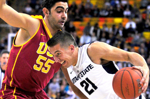 USC center Omzr Oraby tries to cut off a drive by Utah State's Spencer Butterfield during a game earlier this month,