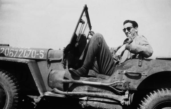 "In a photo from the movie ""Salinger,"" J.D. Salinger sits in his jeep after the liberation of Paris, 1944."